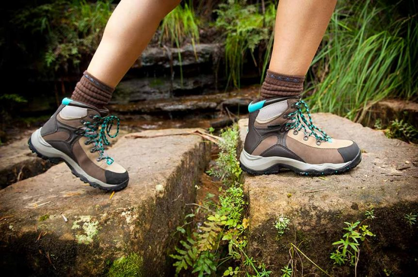 Hiking shoes walking on trail