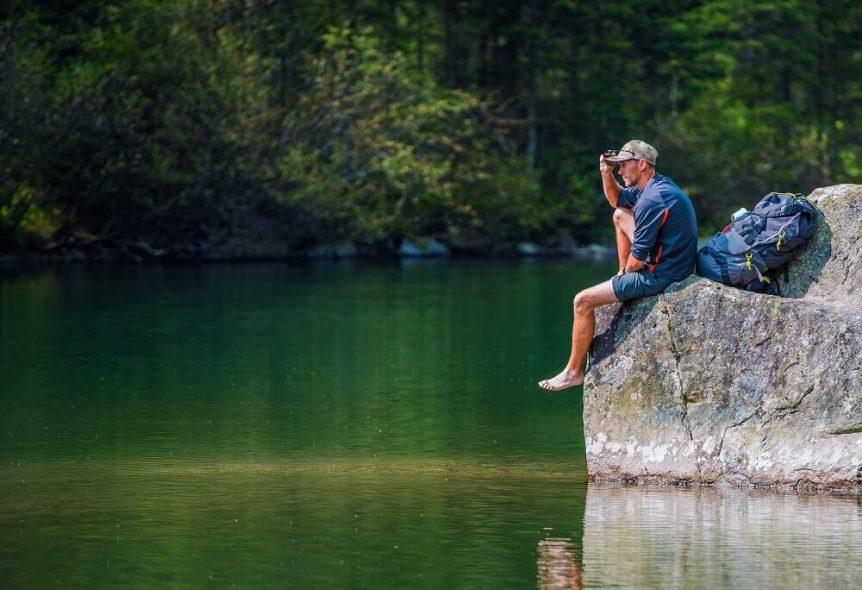 Hiker sitting overlooking lake